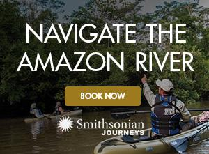 Photo of Smithsonian Journeys travelers kayaking along the Amazon River with a Smithsonian Journeys Expert